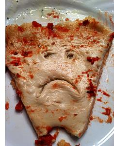 Undercooked Pizza Slice from a Yelp Review
